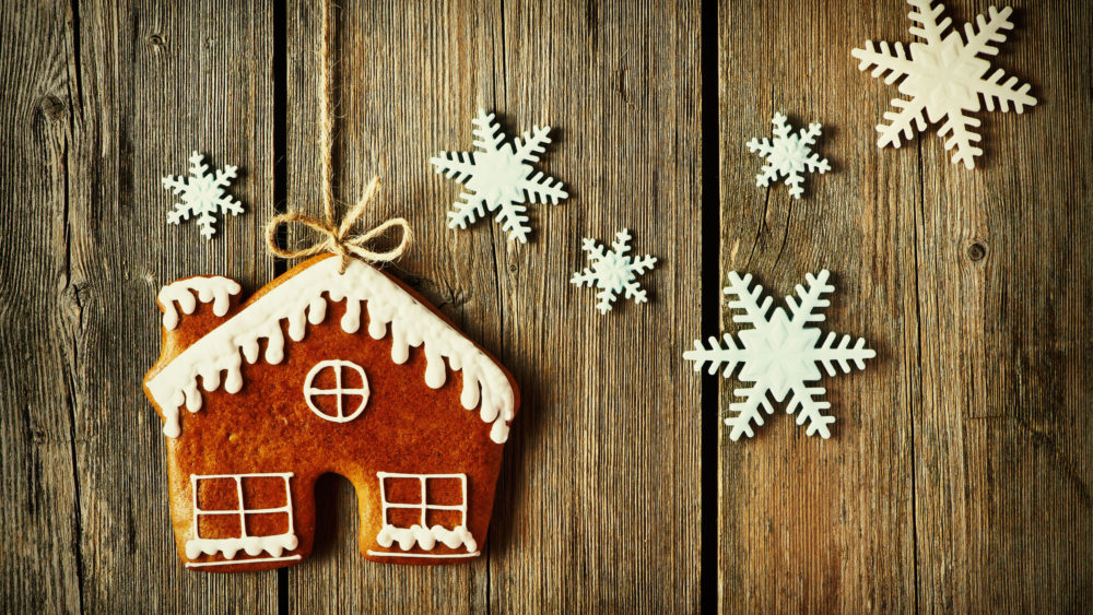 48539512 – christmas homemade gingerbread house cookie over wooden background